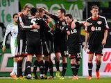 Leverkusen´s players celebrate during the German first division Bundesliga football match VfL Wolfsburg vs Bayer Leverkusen on February 22, 2014