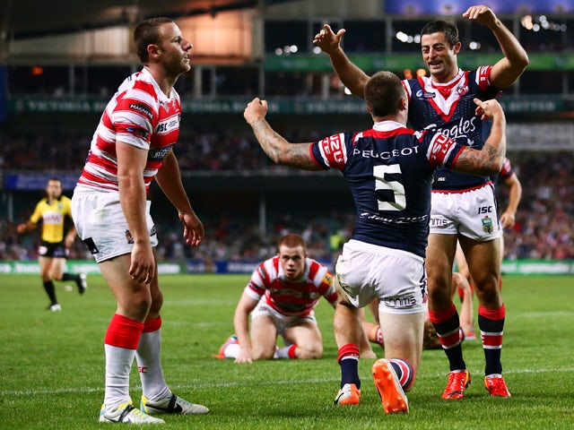 Shaun Kenny-Dowall of the Roosters celebrates with Anthony Minichiello after scoring his second try during the NRL World Club Challenge match between the Sydney Roosters and the Wigan Warriors at Allianz Stadium on February 22, 2014