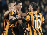 Hull City's English defender Curtis Davies (2nd L) celebrates after scoring his team's first goal against Brighton and Hove Albion during an English FA Cup fifth round replay on February 24, 2014
