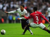 Aaron Lennon takes on Patrice Evra during the League Cup final on March 1, 2009.