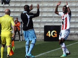 Ajaccio's Ivorian forward Junior Tallo is congratulated by a teammate after scoring a goal during the French L1 football match Ajaccio (ACA) against Lille (LOSC) on March 2, 2014