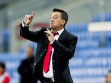 Head coach Allen Bula of Gibraltar gives instructions during the international friendly match between Gibraltar and Slovakia at Estadio do Alagarve on November 19, 2013
