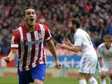 Atletico Madrid's midfielder Koke celebrates after scoring a goal during the Spanish league football match Club Atletico de Madrid vs Real Madrid CF at the Vicente Calderon stadium in Madrid on March 2, 2014