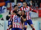 Atletico de Madrid players celebrate after scoring their 2nd goal during the La Liga match between Club Atletico de Madrid and Real Madrid CF at Vicente Calderon Stadium on March 2, 2014
