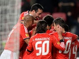 Benfica players celebrate their opening goal against PAOK during their Europa League match on February 27, 2014