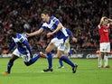 Birmingham City's Obafemi Martins celebrates with Nikola Zigic after scoring during the Carling Cup final football match between Arsenal and Birmingham at the Wembley Stadium in London on February 27, 2011