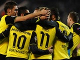 Borussia Dortmund's players celebrate after scoring against Zenit St Petersburg during their UEFA Champions League last 16, first-leg tie on February 25, 2014