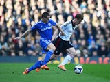 Scott Parker of Fulham holds off Cesar Azpilicueta of Chelsea during the Barclays Premier League match between Fulham and Chelsea at Craven Cottage on March 1, 2014