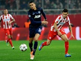 Manchester United's Chris Smalling and Olympiakos' Hernan Perez in action during their Champions League match on February 25, 2014