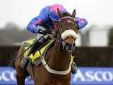 Joe Tizzard riding Cue Card clear the last to win The Betfair Ascot Steeple Chase at Ascot racecourse on February 16, 2013