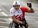 Britain's David Weir celebrates winning the men's wheelchair race in the Great North Run half marathon in South Shields, near Newcastle in northeast England on September 15, 2013