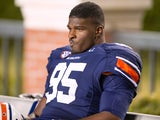 Defensive end Dee Ford #95 of the Auburn Tigers reacts on the bench during their game against the Georgia Bulldogs on November 10, 2012