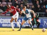 Emile Sinclair of Northampton Town looks for the ball with Tom Lockyer of Bristol Rovers during the Sky Bet League Two match on March 1, 2014