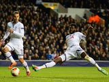 Teottenham's Emmanuel Adebayor scores his team's second goal against Dnipro during their Europa League match on February 27, 2014