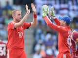 English bowler Stuart Broad celebrates with Jos Buttler after taking the wicket of West Indies batsman Darren Bravo during the second One Day International match bewteen West Indies and England at the Sir Vivian Richard Stadium in St John's, March 2, 2014