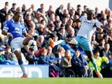Sylvain Distin of Everton is challenged by Carlton Cole of West Ham United during the Barclays Premier League match between Everton and West Ham United at Goodison Park on March 1, 2014