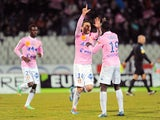 Evian's French midfielder Cedric Barbosa celebrates with teammates after scoring a goal during the French L1 football match between Evian (ETGFC) and Nantes (FCN) on February 28, 2014