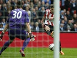 Sunderland striker Fabio Borini scores the opening goal past Manchester City goalkeeper Costel Pantilimon during the League Cup final at Wembley on March 2, 2014