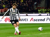 Juventus' Spanish foward Fernando Llorente scores a goal during the Serie A football match between AC Milan and Juventus at San Siro Stadium in Milan on March 02, 2014
