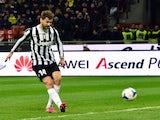 Juventus' Spanish foward Fernando Llorente scores a goal during the Serie A football match between AC Milan and Juventus at San Siro Stadium in Milan on March 02, 2014