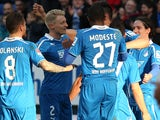 Hoffenheim's players celebrate during the German first division Bundesliga football match TSG 1899 Hoffenheim vs VfL Wolfsburg in Sinsheim, Germany, on March 2, 2014