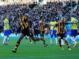 Curtis Davies of Hull City celebrates as he scores their first goal during the Barclays Premier League match between Hull City and Newcastle United at KC Stadium on March 1, 2014
