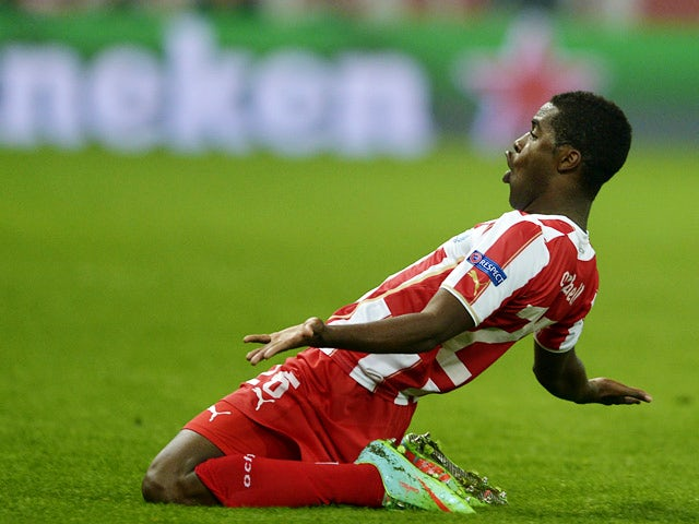 Olympiakos' Joel Campbell celebrates after scoring his team's second goal against Manchester United during their Champions League match on February 25, 2014
