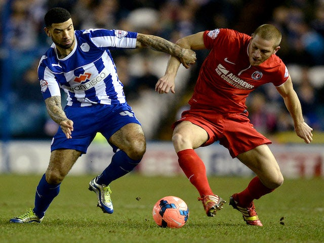Leon Best of Sheffield Wednesday is challenged by Michael Morrison of Charlton Athletic during the Budweiser FA Cup Fifth Round match on February 24, 2014