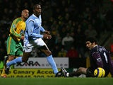 Norwich's Leon McKenzie scores against Manchester City during their Premier League match on February 28, 2005