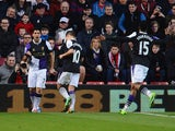 Luis Suarez of Liverpool celebrates scoring the opening goal during the Barclays Premier League match between Southampton and Liverpool at St Mary's Stadium on March 1, 2014