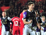 Liverpool's English midfielder Steven Gerrard celebrates after scoring his team's third goal during the English Premier League football match between Southampton and Liverpool at St Mary's Stadium in Southampton, southern England on March 1, 2014