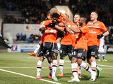 Lorient's Gabonese defender Bruno Ecuele Manga celebrates with teammates after scoring a goal during the French L1 football match between Lorient and Bastia on March 1, 2014
