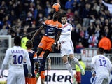 Montpellier's French forward Mbaye Niang vies with Lyon's French midfielder Maxime Gonalons during the French L1 football match between Olympique Lyonnais (OL) and Montpellier on March 2, 2014