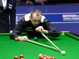 Mark Williams plays a shot in his second round match against Ronnie O'Sullivan during The Betfred.com World Snooker Championship at Crucible Theatre on April 30, 2012