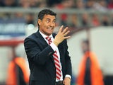Olympiakos manager Michel Gonzalez gestures on the touchline against Manchester United during their Champions League match on February 25, 2014