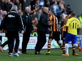 Fourth official Howard Webb restrains David Meyler of Hull City after a clash with Alan Pardew manager of Newcastle United during the Barclays Premier League match between Hull City and Newcastle United at KC Stadium on March 1, 2014