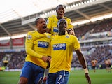 Moussa Sissoko of Newcastle United celebrates with Loic Remy after scoring their third goal during the Barclays Premier League match between Hull City and Newcastle United at KC Stadium on March 1, 2014