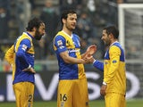 Marco Parolo, Mattia Cassani and Walter Gargano of Parma FC celebrate their victory at the end of the Serie A match between US Sassuolo Calcio and Parma FC on March 2, 2014