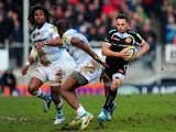 Exeter centre Phil Dollman (r) makes a break past Marland Yarde (l) and Topsy Ojo of London Irish during the Aviva Premiership match on March 1, 2014