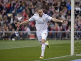 Real Madrid's French forward Karim Benzema celebrates after scoring during the Spanish league football match Club Atletico de Madrid vs Real Madrid CF at the Vicente Calderon stadium in Madrid on March 2, 2014