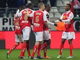 Reims' players celebrate after Nicolas de Preville scored a goal during the French football match between Reims and Valenciennes on March 1, 2014