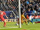 Leicester City's Jamie Vardy scores the opener past Charlton Athletic's Ben Hamer during the Sky Bet Championship match against Charlton Athletic on March 1, 2014
