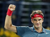 Roger Federer of Switzerland reacts after beating Novak Djokovic of Serbia in their semi-final match in the ATP Dubai Duty Free Tennis Championships on February 28, 2014