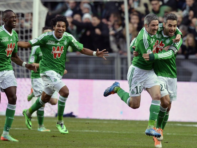 Saint-Etienne's French midfielder Fabien Lemoine celebrates with his teammates after scoring a goal during the French L1 football match between Saint-Etienne (ASSE) and Monaco (ASMFC) on March 1, 2014