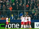 Salzburg's teammates celebrate their goal against Ajax during their Europa League match on February 27, 2014