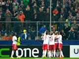 Salzburg's teammates celebrate their goal against Ajax during their Europa League match on February 27, 2014