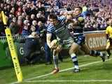 Joel Tomkins of Saracens is knocked into touch, just short of the try line by Bath standoff George Ford during the Aviva Premiership match between Bath and Saracens at the Recreation Ground on February 28, 2014