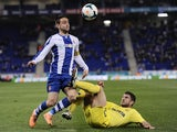 Espanyol's Sergio Garcia vies with Villarreal's Bojan Jokic during a Spanish league football match on February 24, 2014
