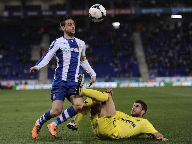 Espanyol's Sergio Garcia vies with Villarreal's Bojan Jokic during a Spanish league football match on February 24, 2014
