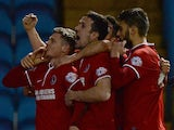 Simon Church (L) of Charlton Athletic celebrates scoring with team mates during the Budweiser FA Cup Fifth Round match against Sheffield Wednesday on February 24, 2014